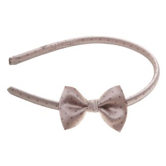 Pretty Woman bow headband on beige