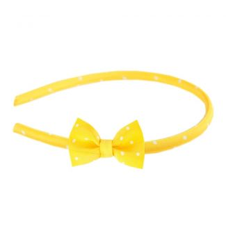 Pretty Woman bow headband on yellow