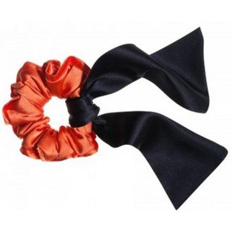 Orange hair twist and black scarf